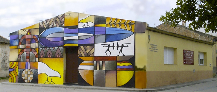 Headquarters of the Federico Wattenberg Center for Vaccean Studies in Padilla de Duero, with its famous mural by Manolo Sierra.